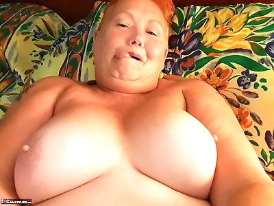 Fat granny with red hair..