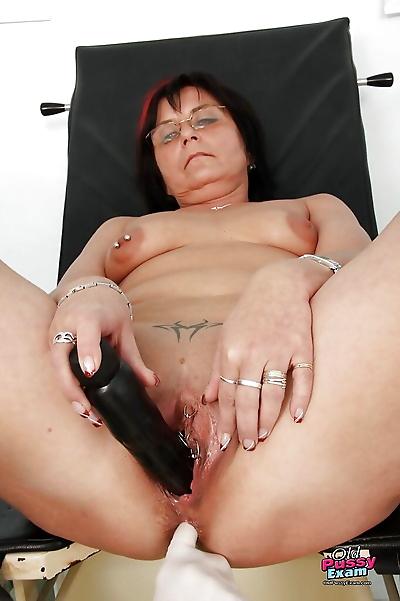 Fatty granny in glasses gets..