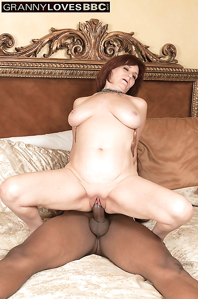 Mature redhead with a little..