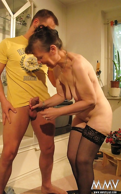 Naked granny Margit D guides and young boy thru his first sex experience