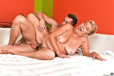 Busty nan seduces a young..