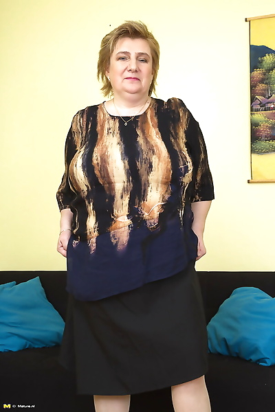 Fat granny removes her bra..