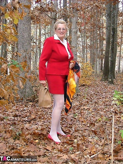 Horny granny Adonna removes..