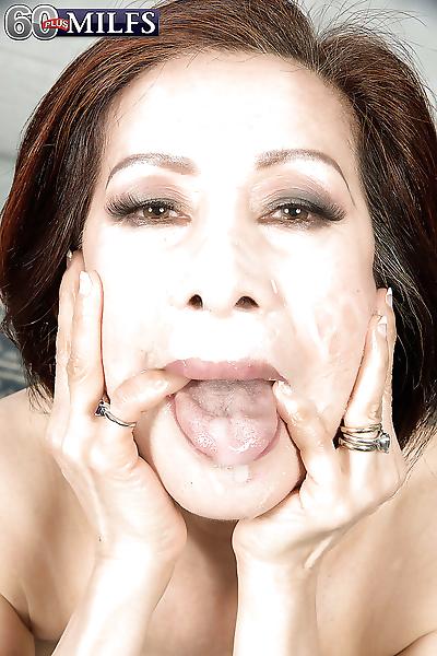 Busty Asian granny Kim Anh..