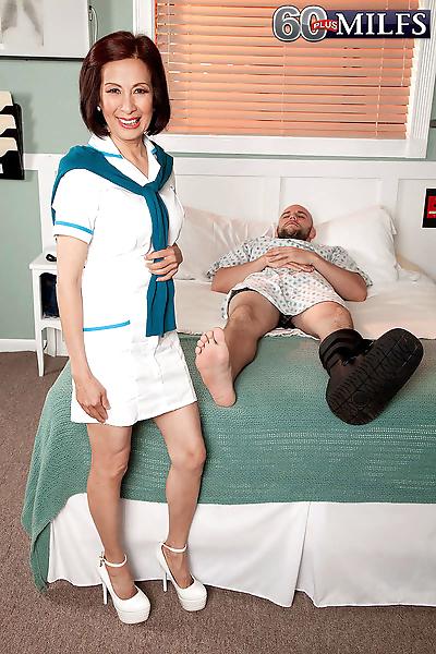 Mature nurse kim anh fucks a..