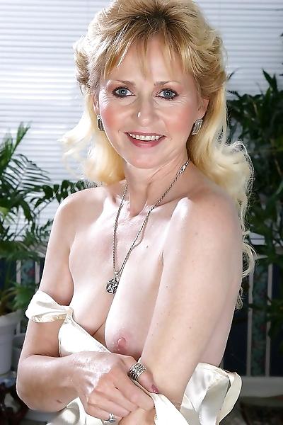 Hot grandma lynn spreads her..