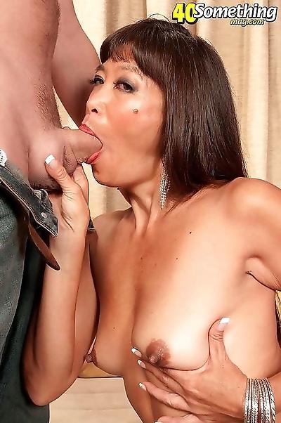 Busty asian mature sucking..