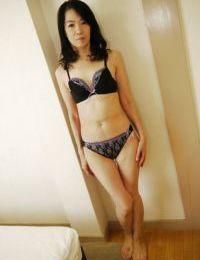 Asian mom Yukiko Asaba playing with nylon covered hairy vagina