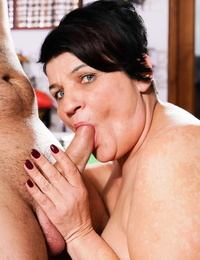 Horny old granny gets a big tit massage and a face full of younger man cum