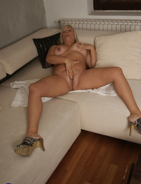 Blonde mature Kirsa shows off her BBW body while masturbating in the shower