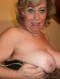 Horny old granny Caro bares saggy big tits & hairy pussy closeup in pantyhose