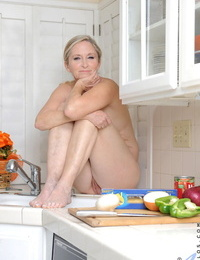 Mature housewife Annabelle Brady washing her hungry pussy in the kitchen sink