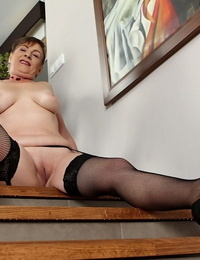 Busty short haired granny Sandra Green fondling her nice older woman tits